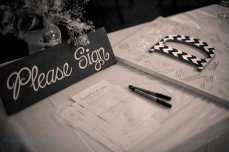 sign in table at wedding with sign