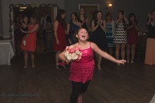 girl catches bouquet at wedding