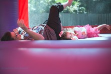 girl and lady laughing in bounce castle