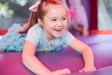 happy girl in bounce castle