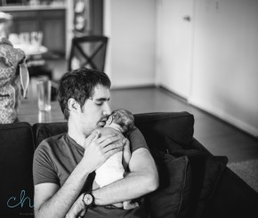 dad and baby on couch