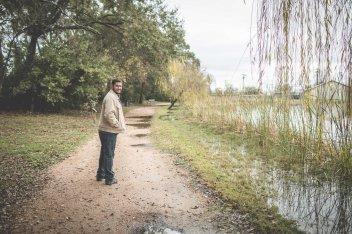 man walking in wet park