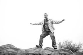 man balancing on rocks