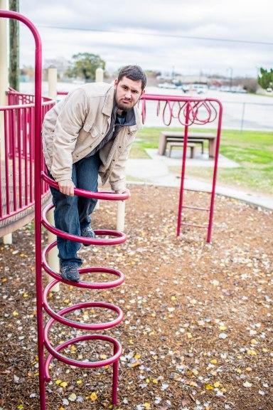 grumpy man on playground