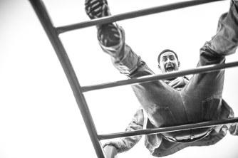 man on climbing bars