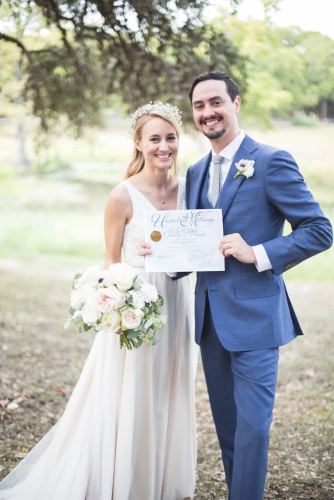 bride and groom with wedding certificate