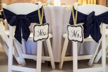 mr and mrs signs on chairs