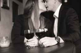 couple with wine kissing