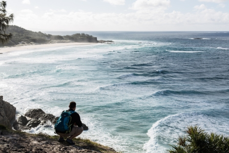 man looking at waves on stradbroke