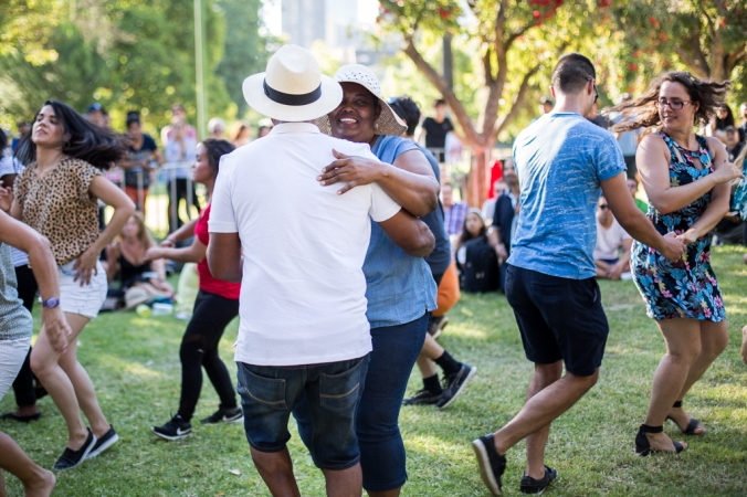 couples salsa dancing in the park
