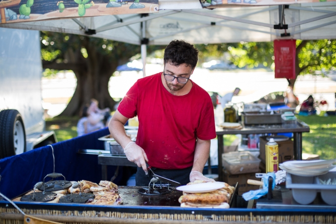 man making cuban sandwiches