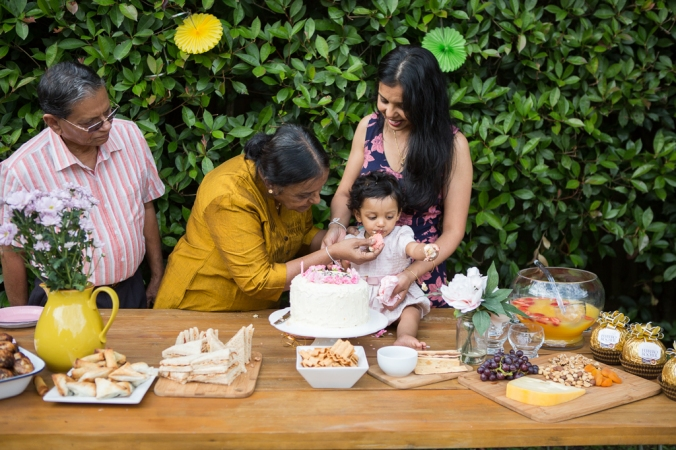 family at first birthday party