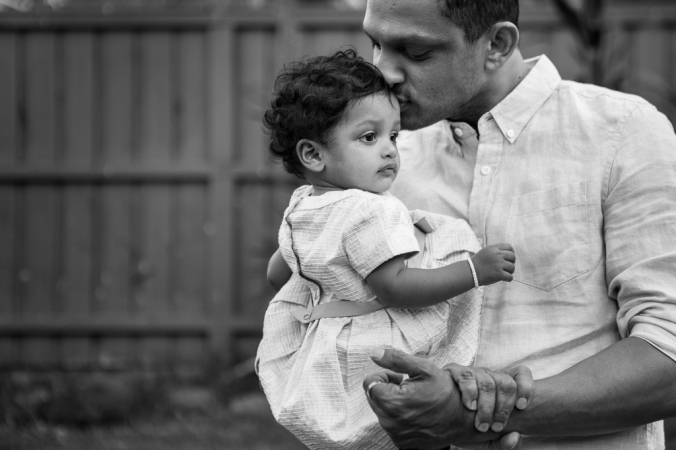 black and white photo of dad with baby girl