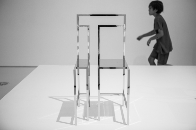 boy running by chair art