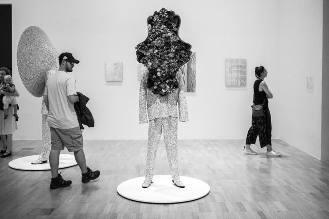 man and flower sculpture