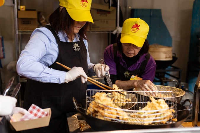 women cooking tempura at buddha festival