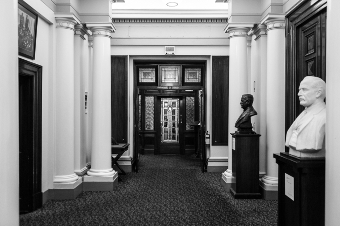 hallway with columns and statues